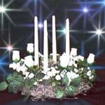 Midnight centerpiece includes the roses, tapered candles and foliage